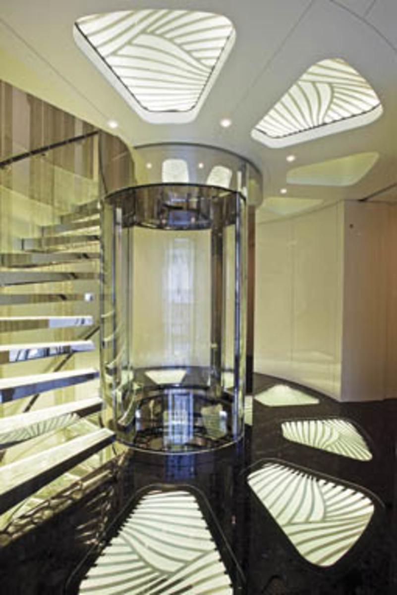 The elevator in Quinta Essentia's atrium features glass all around.