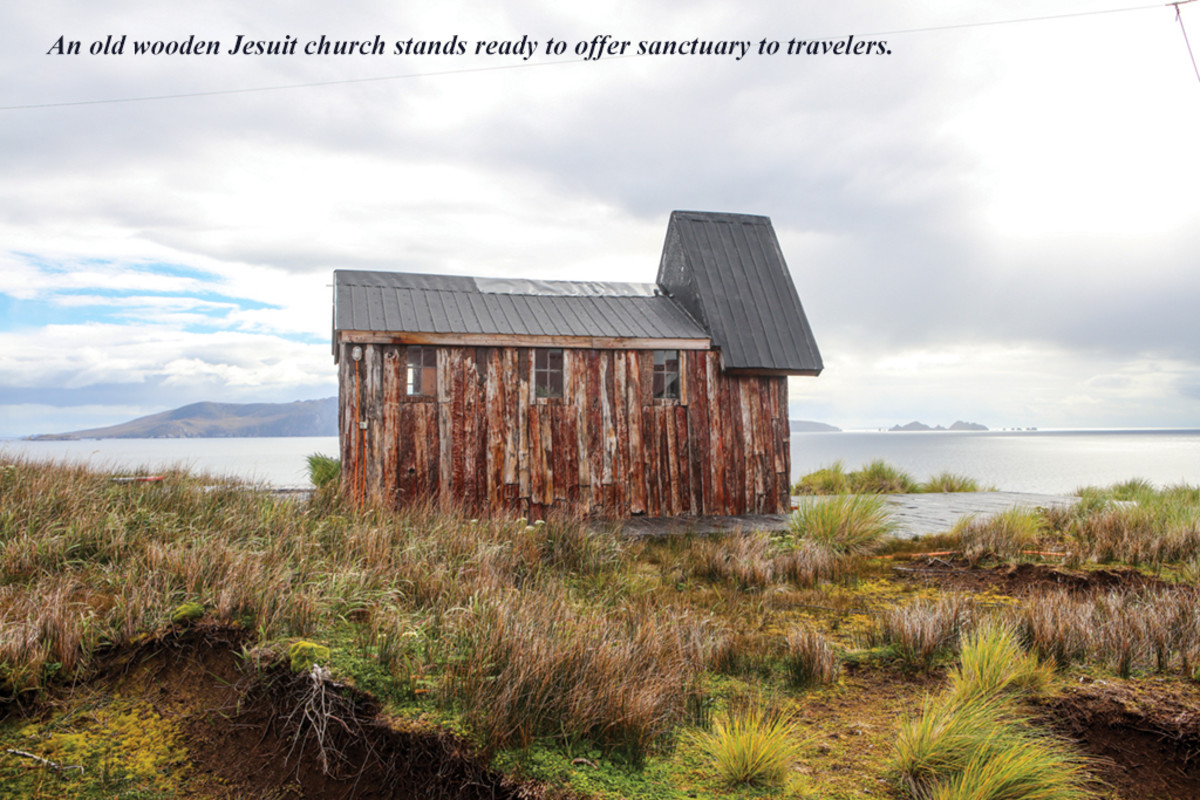 An old wooden Jesuit church stands ready to offer sanctuary to travelers.