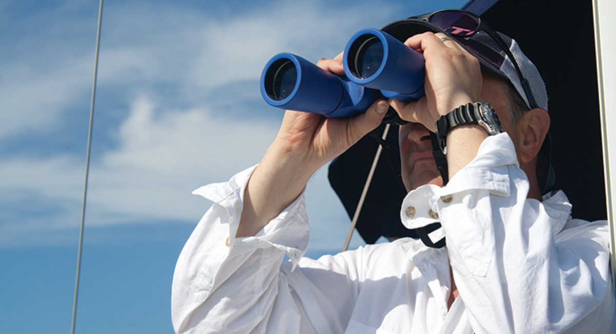 Jason Y. Wood using binoculars