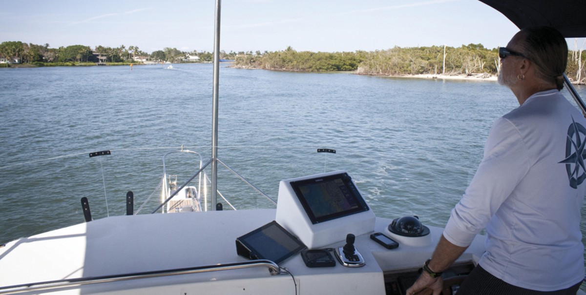 Capt. Tommy McCoy enjoys a beautiful Florida cruising day at the helm of Arawak, simplified by the Simrad helm setup.