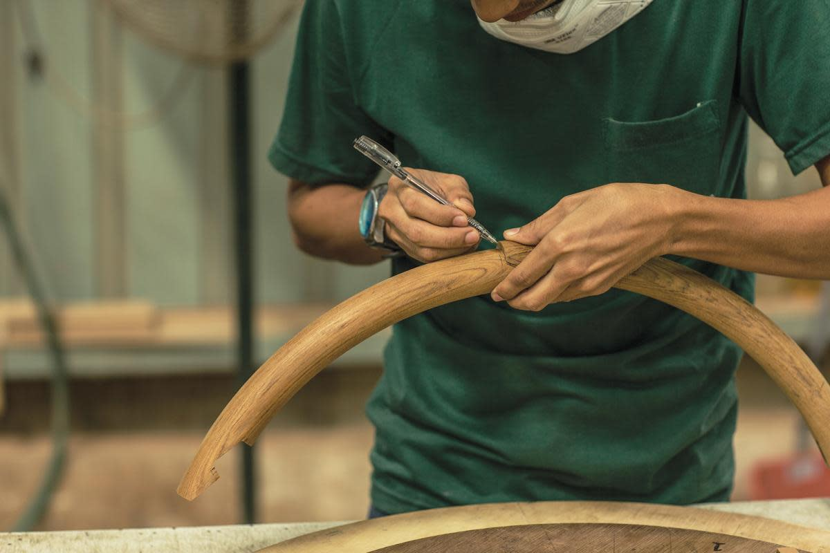 Hands of a craftsman at the Grand Banks facility in Malaysia