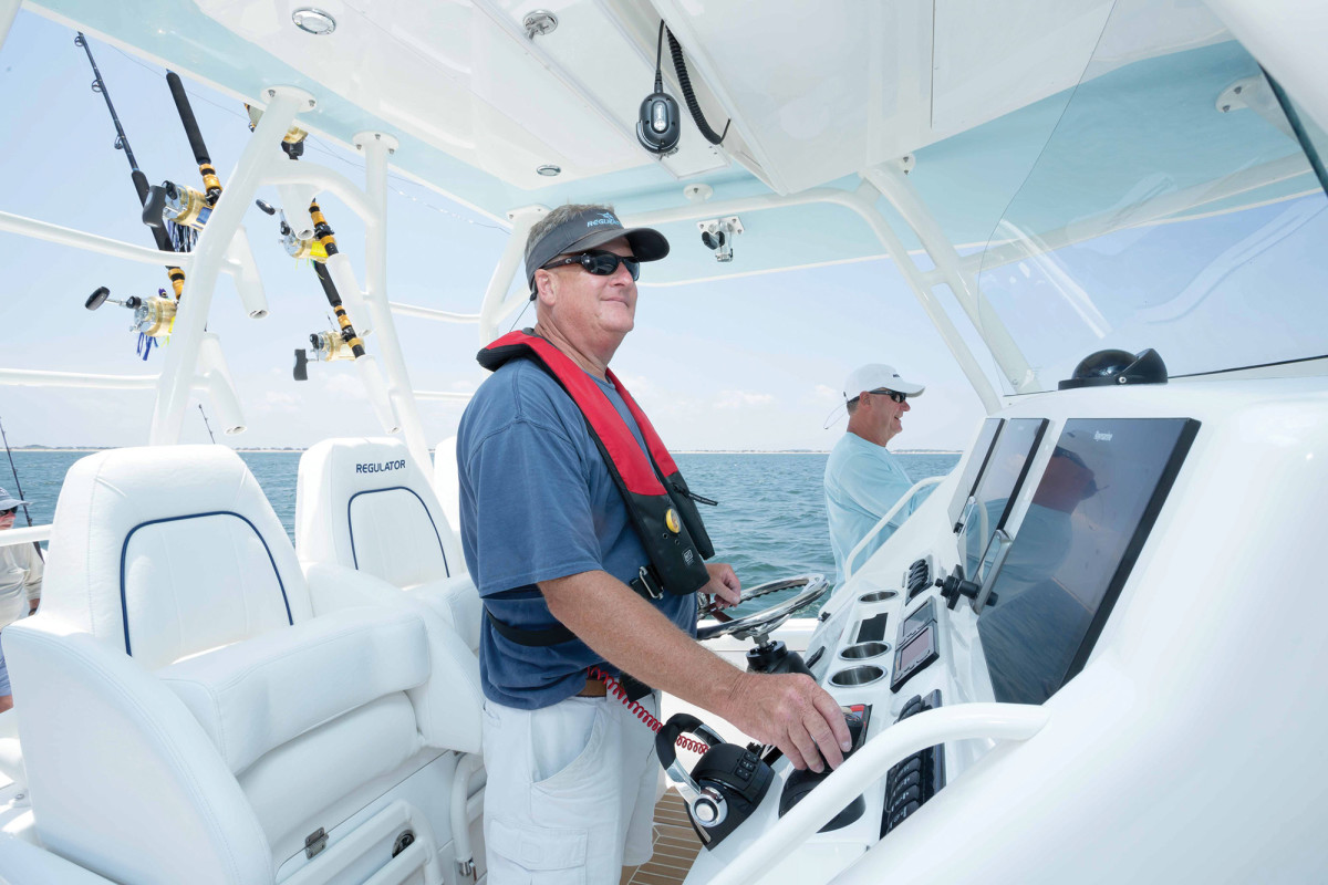 Capt. at helm