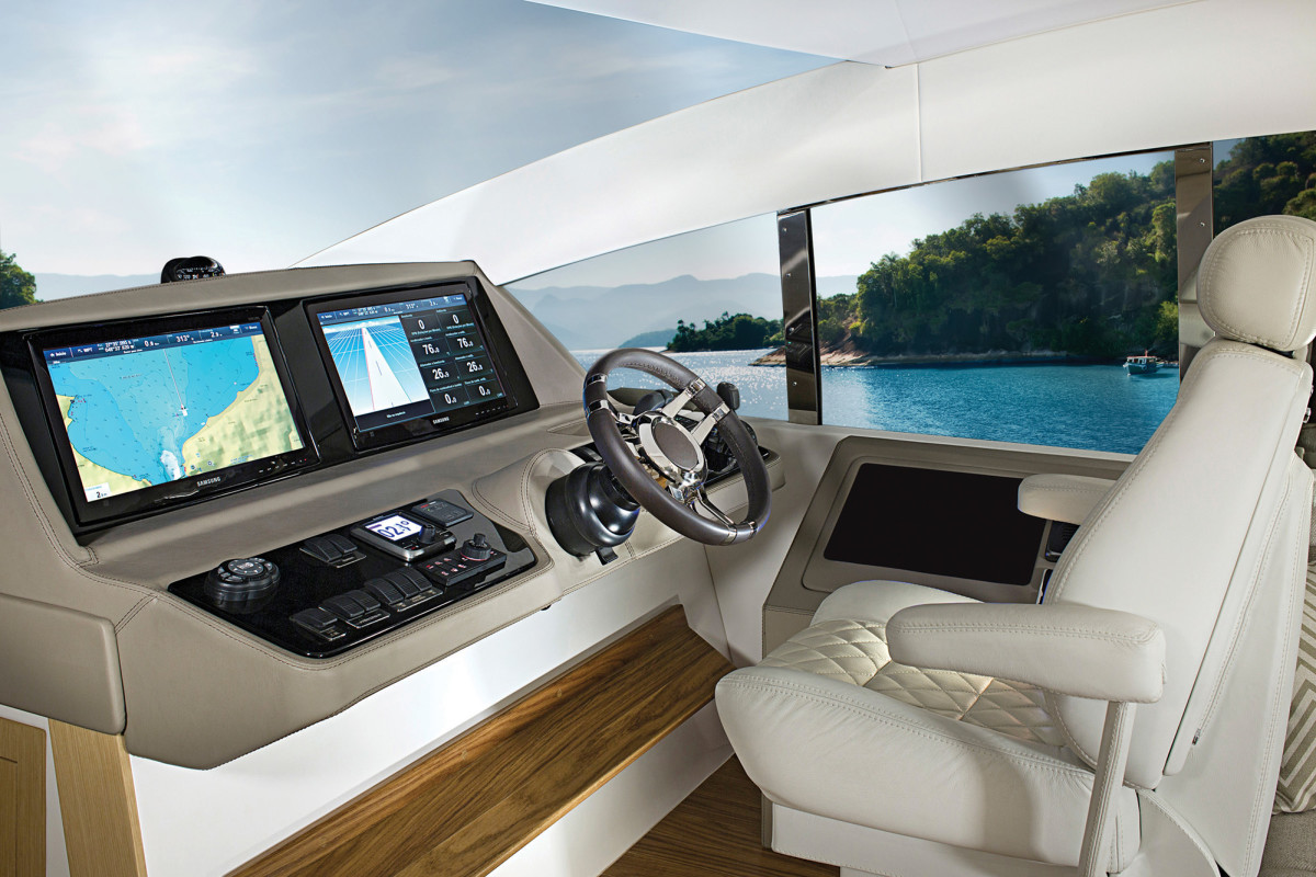 No distractions! The helm is situated far forward, with a single chair, an expansive helm dash, and glass all around.