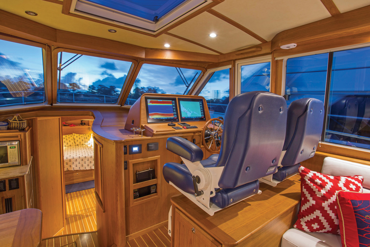 A standard sliding side door at the helm is great for fresh air and docking.