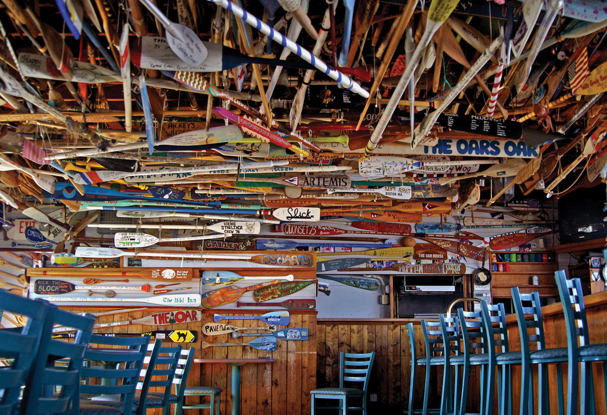 You could spend an entire day trying to count the colorfully decorated oars that line almost every wall and ceiling at The Oar.