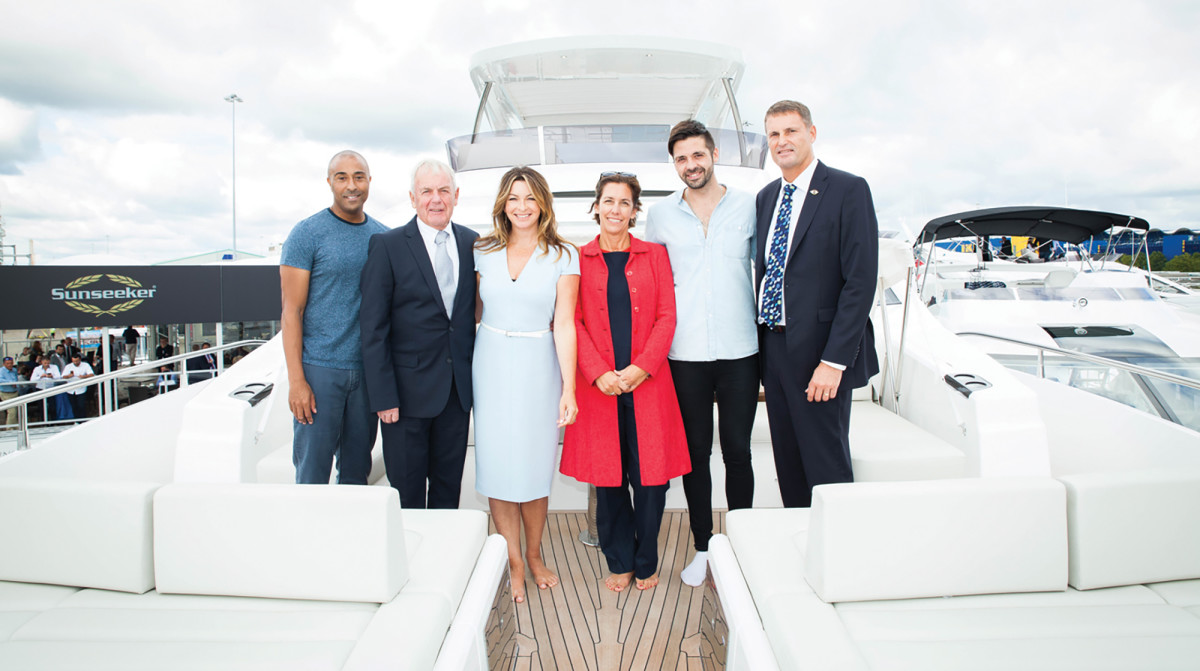 CEO of Sunseeker International Phil Popham (far right) and Olympian Colin Jackson, BLUE Ambassador (far left), join CEO of the Blue Marine Foundation Clare Brook (middle) to announce the partnership at the Southhampton Boat Show.