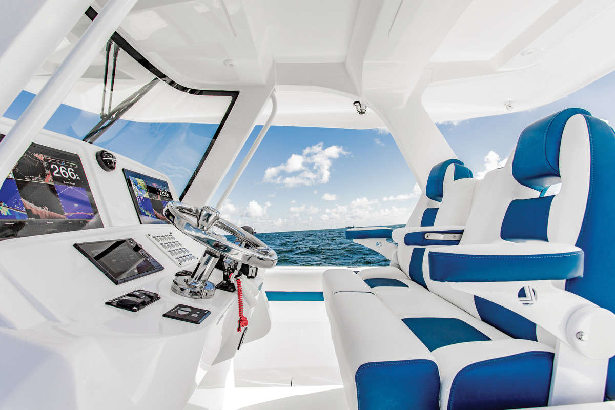 Plush helm seats within easy reach of beefy handrails are essential when cruising on the fun side of 50 knots.