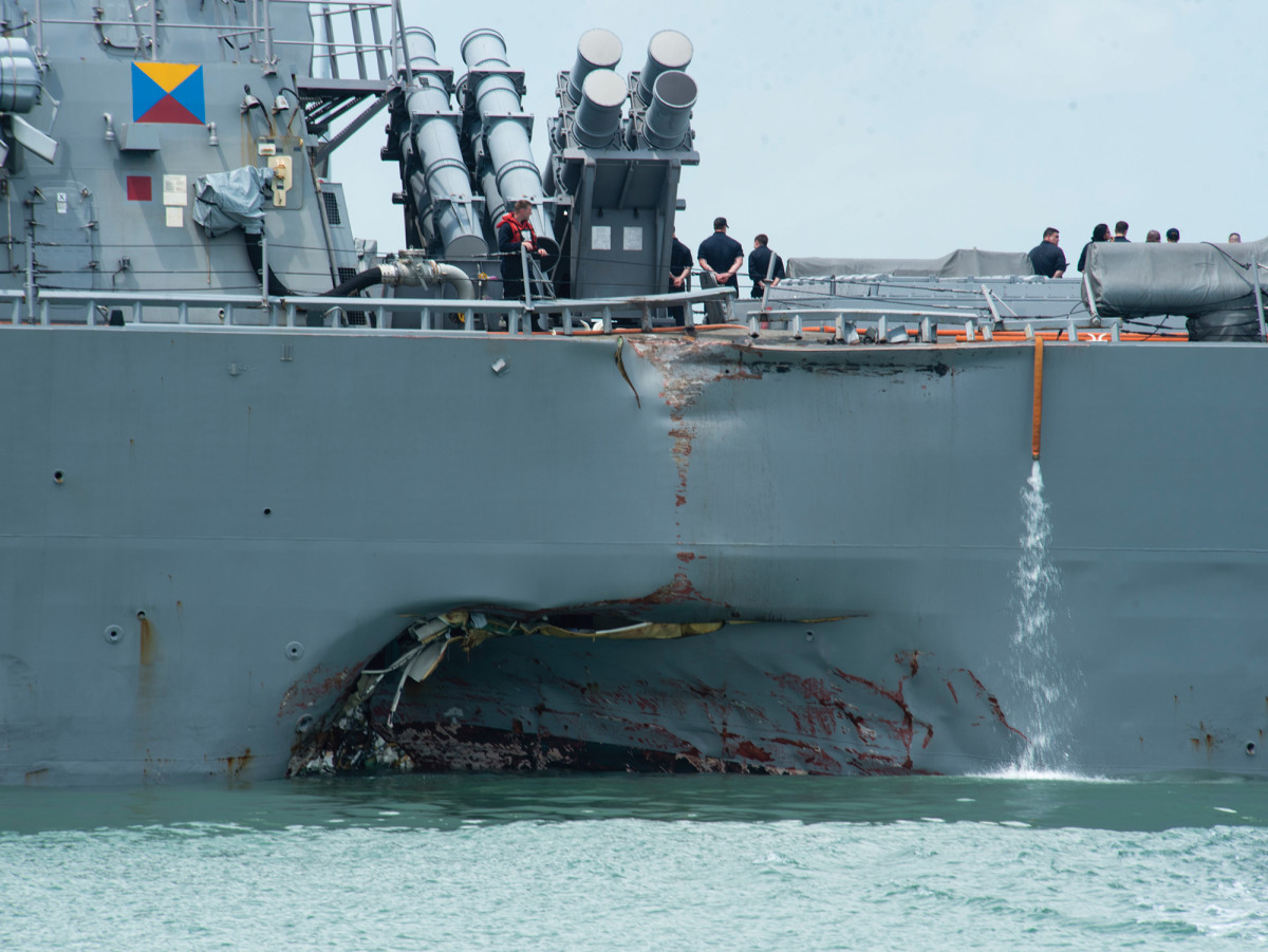 The USS John S. McCain's port quarter was seriously damaged, both above and below the waterline.