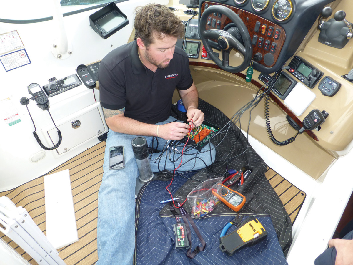 The small Dockmate receiver mounts out of sight at the helm.