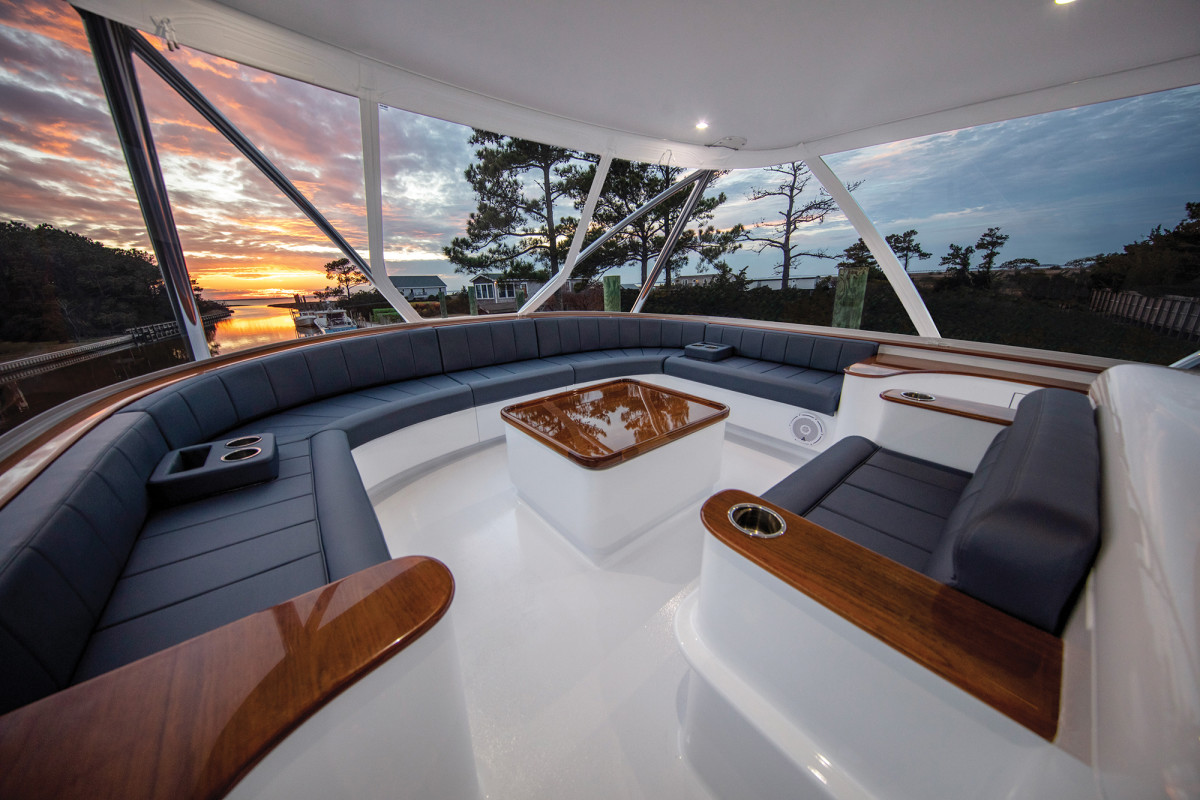 Multiple seating areas forward of the Palm Beach-style helm match the upholstery of the helm seats and mezzazine seating.