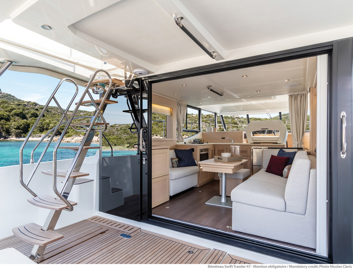 The 47's airy salon. Note the beefy handrails on the ladder to the flybridge.