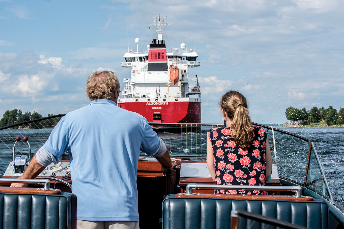 Antique boats share the St. Lawrence with cargo ships, pontoons and more.