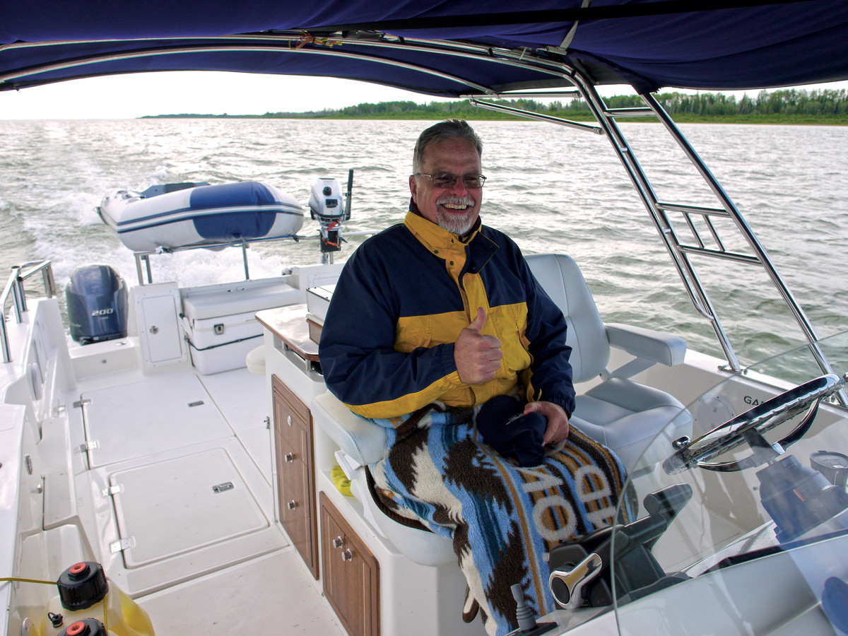 Aspen Power Catmarans founder Larry Graf at the helm of his modified 32-footer.