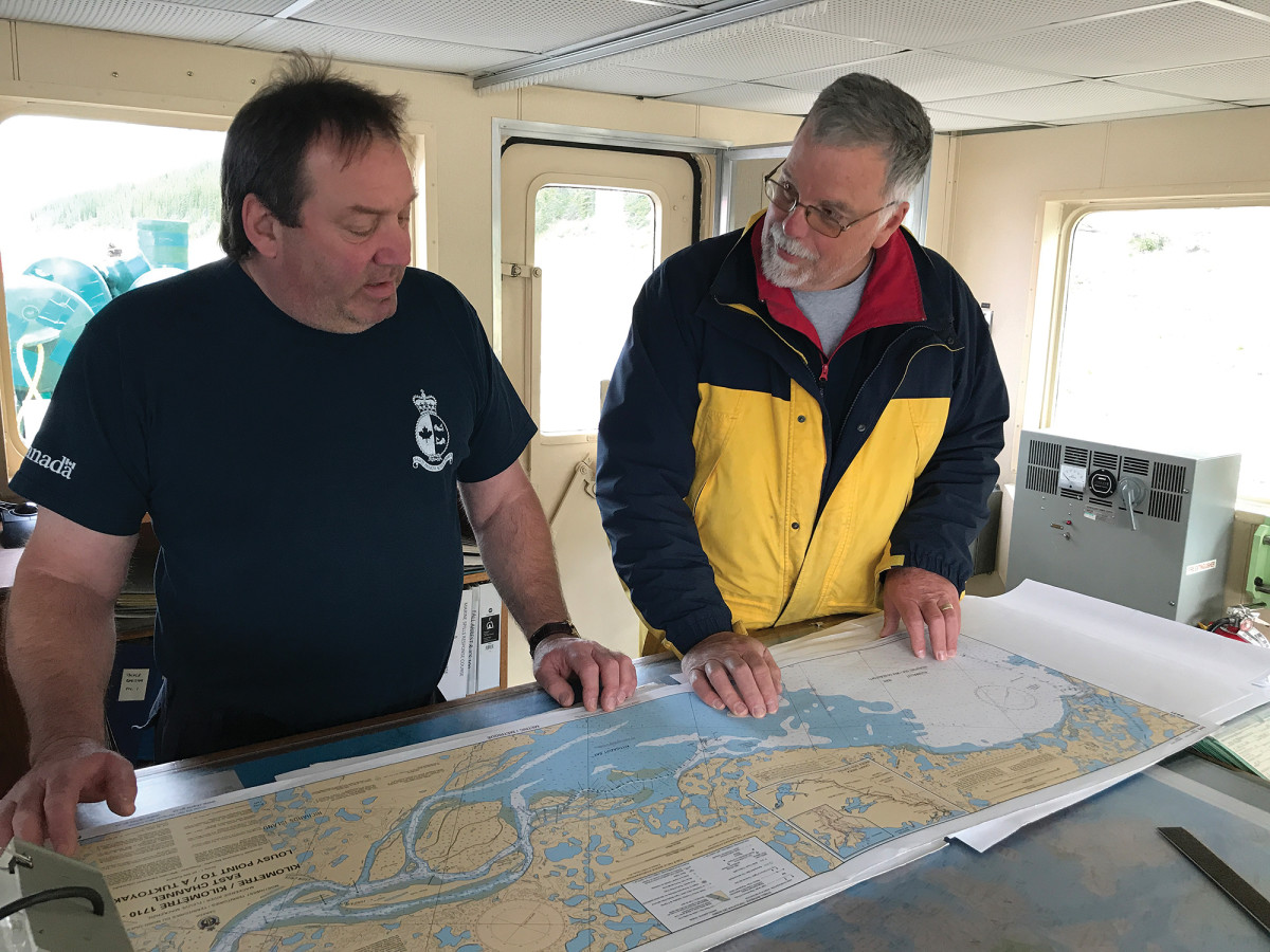 With no electronic navigation charts for the Mackenzie, the crew relied on over two dozen paper charts.