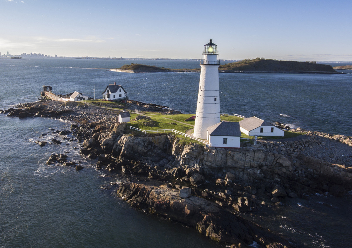 The Boston Light on Little Brewster Island guards the entrance to Boston Harbor, casting a beam 27 miles into the Atlantic.