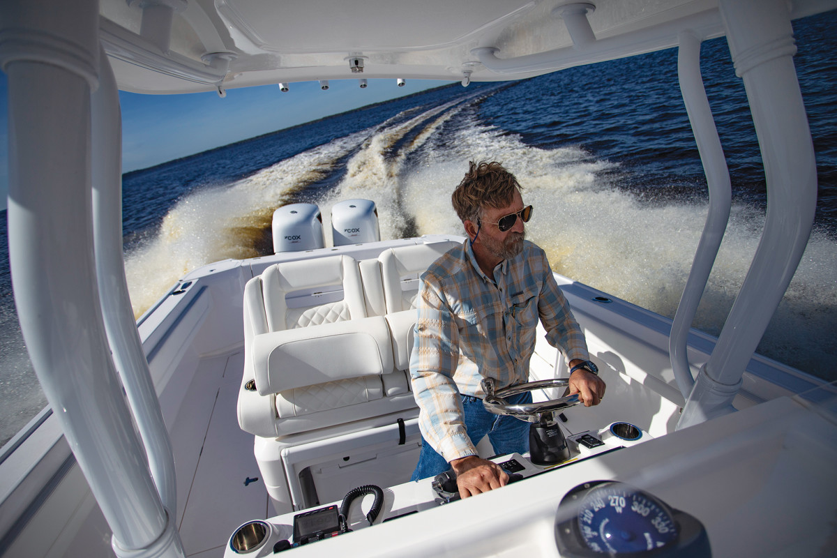 The author tests the CXO300 diesel V8 outboards on the St. Johns River—the first sea trial of this new technology conducted by a U.S. magazine.