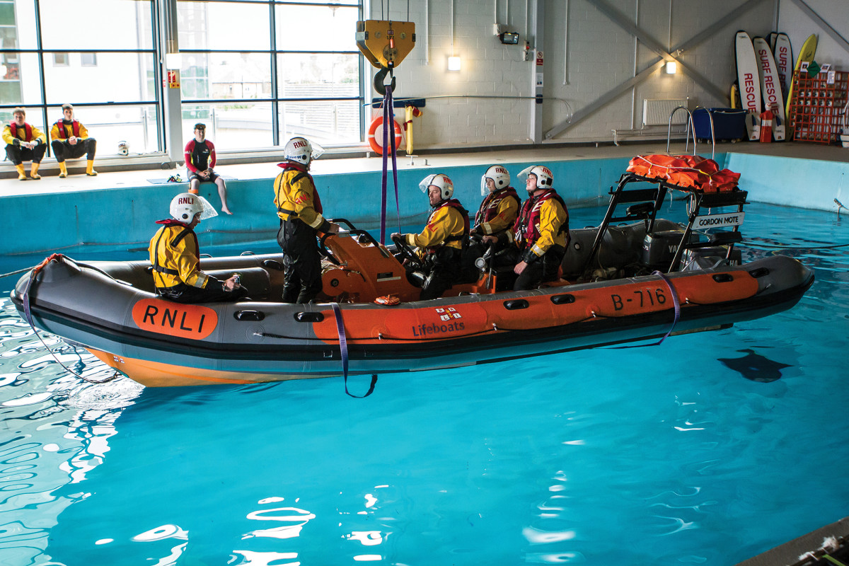 Some capsize training takes place in a pool at RNLI's Poole station.