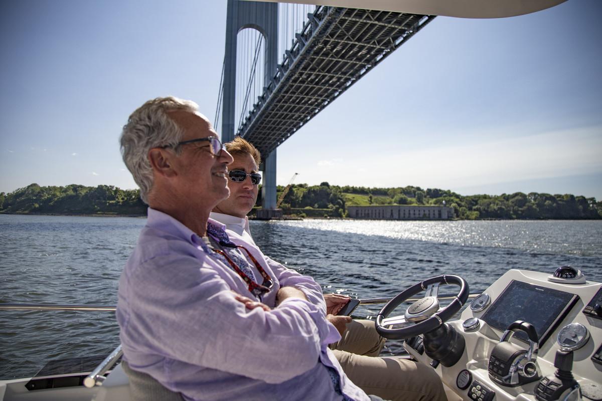 Marine Group President Gary DeSanctis and Prestige U.S. President Nick Harvey soak up the view of lower Manhattan from the flybridge.