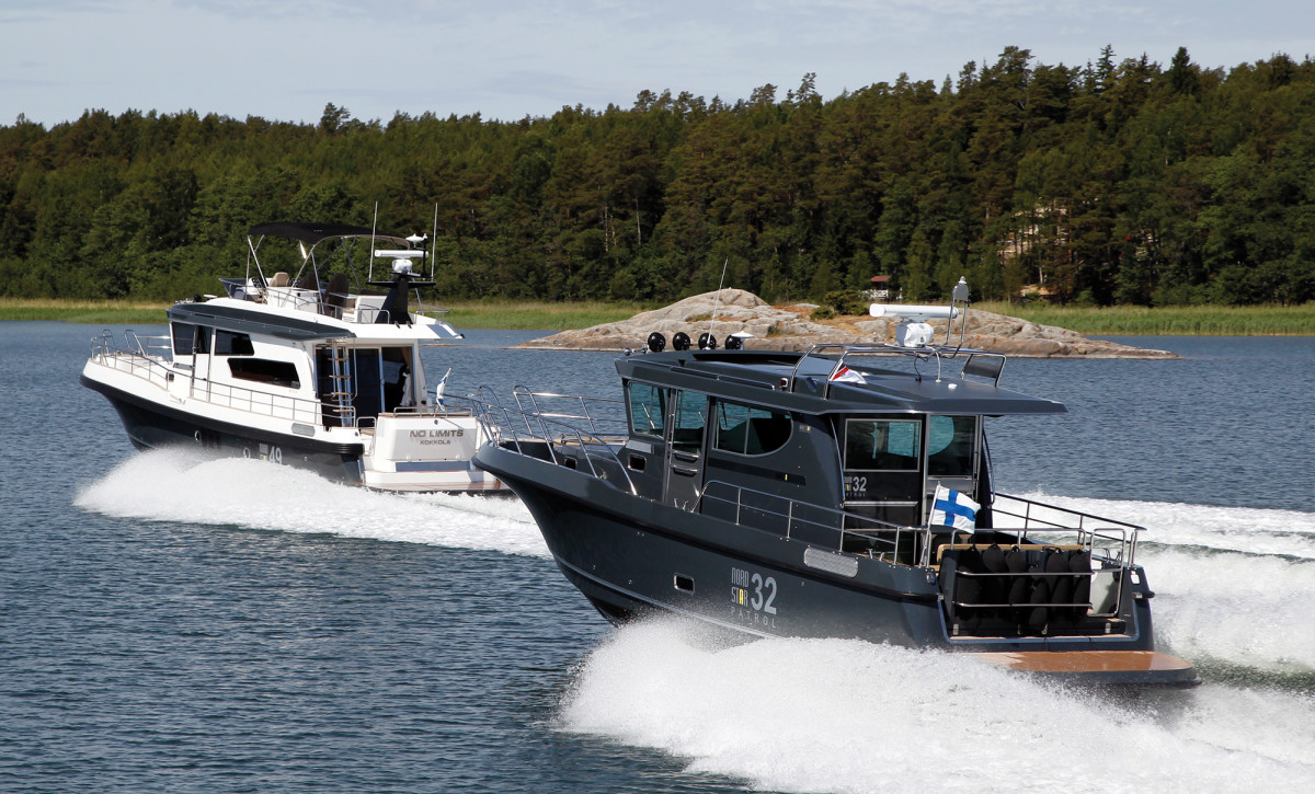 Nord Star's 49 SCY and 32 Patrol models dash past a skerry set just offshore of a typical island in The Archipelago.