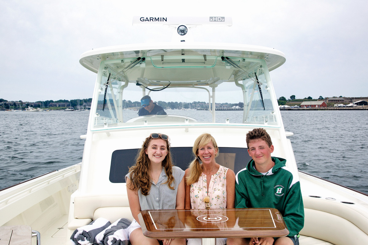 Family bonding in the bow of Hinckley's first sport boat with outboard power.