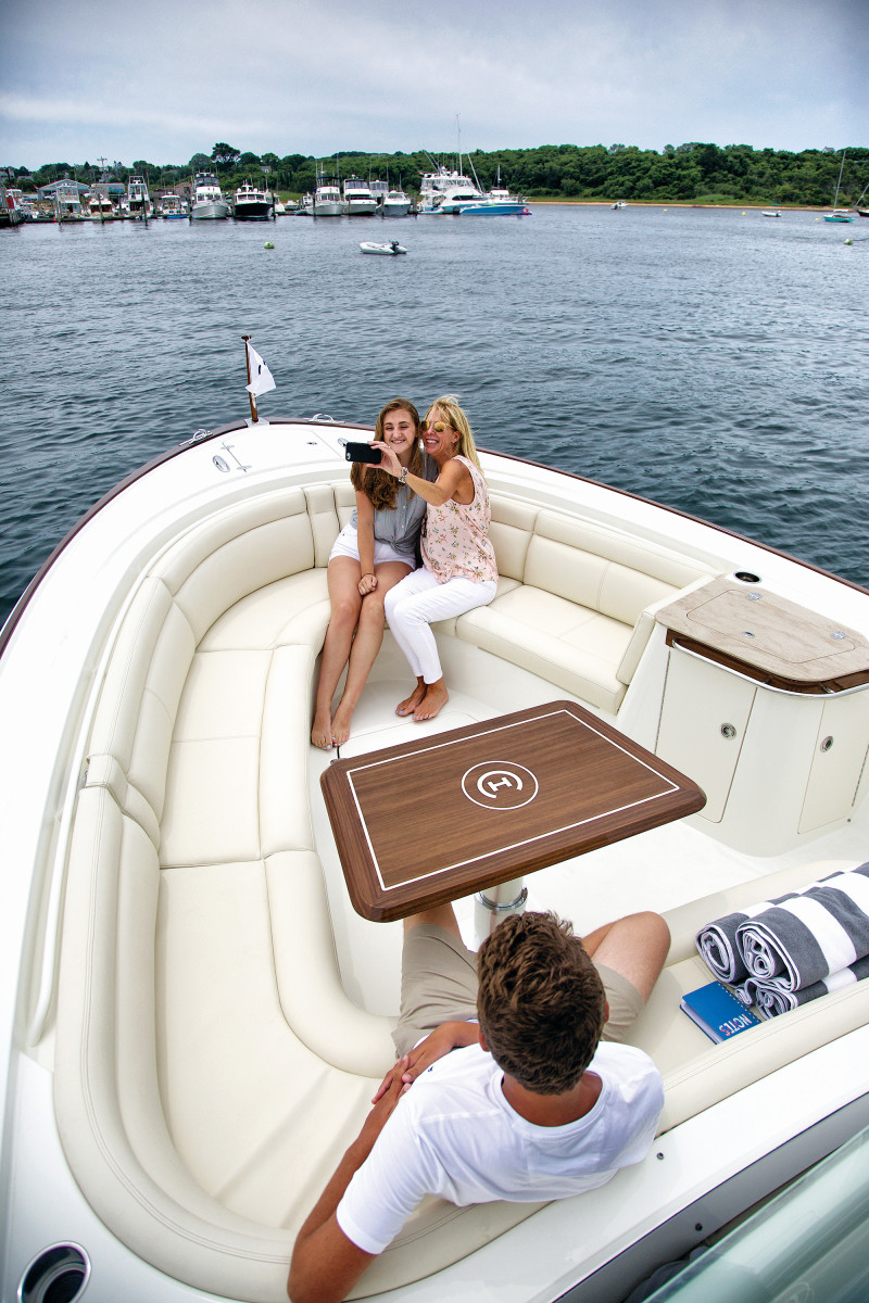 Contoured seats in the bow and the artisinal teak toe rail are picture perfect.