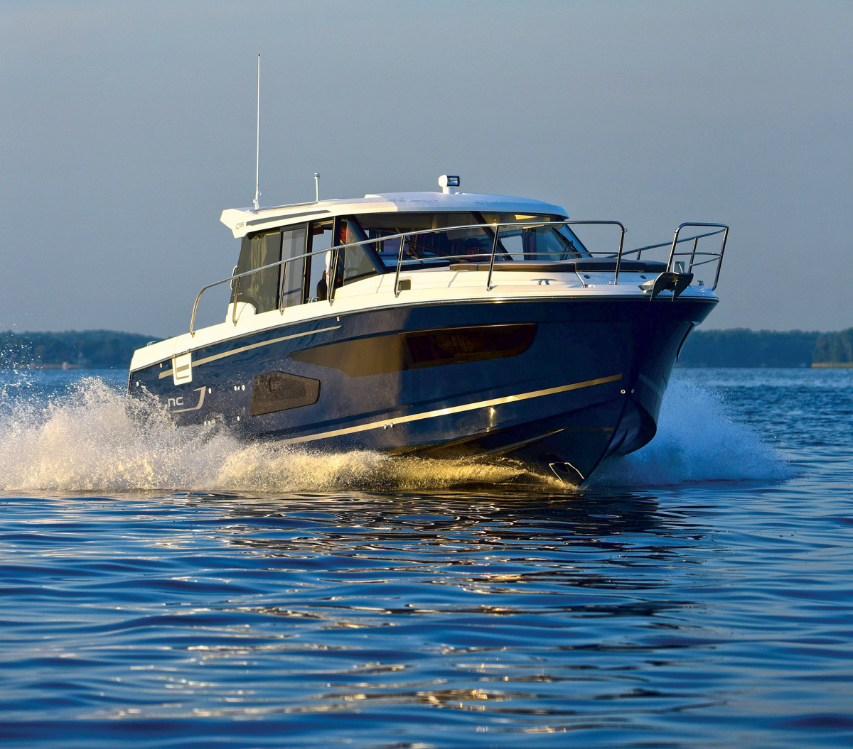 Twin 300-hp Yamaha outboards propel the NC 1095 to a top hop of 37 knots.