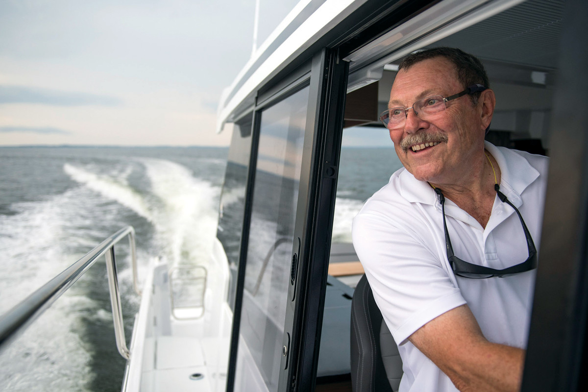 The author clearly enjoying himself at the helm of the Jeanneau NC 1095.