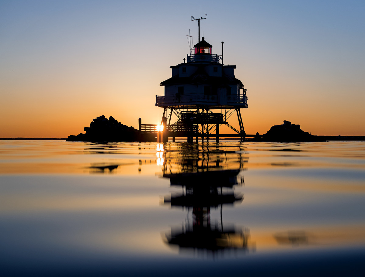 The sun rises behind Thomas Point Shoal Light, a favorite fishing spot of the author.