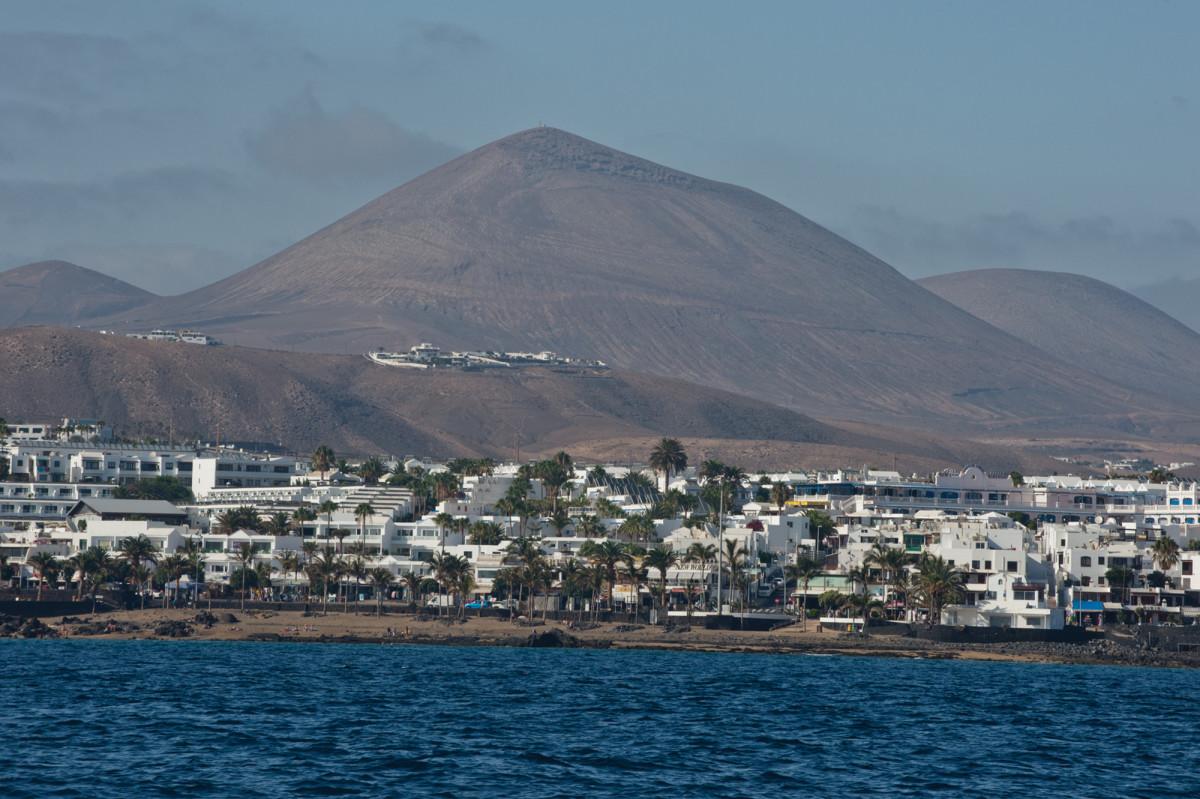 Puerto del Carmen sprawls along the Lanzarote shoreline.