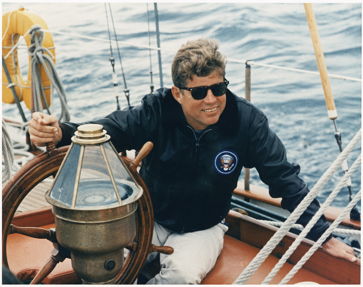 JFK at the helm of Manitou.