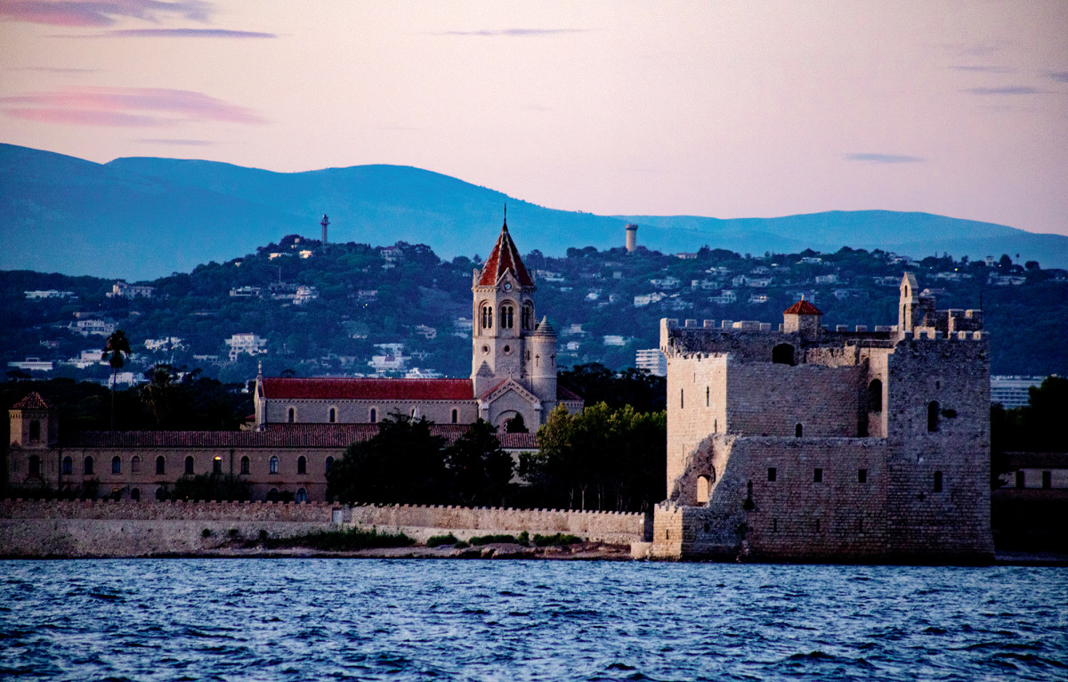 The 11th century Saint Honorat castle ruins—aged by wind and tide—seem to spill onto the Bay of Cannes.