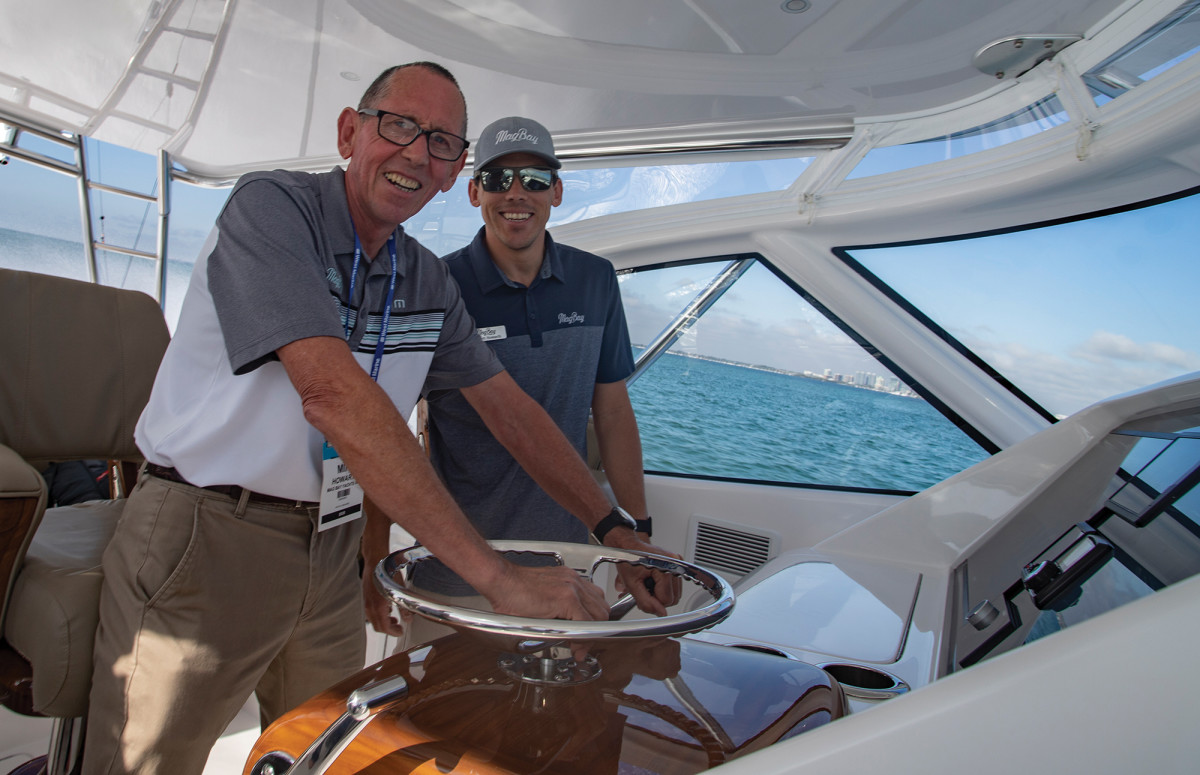Mike and Barrett Howarth at the helm of the Mag Bay 42.