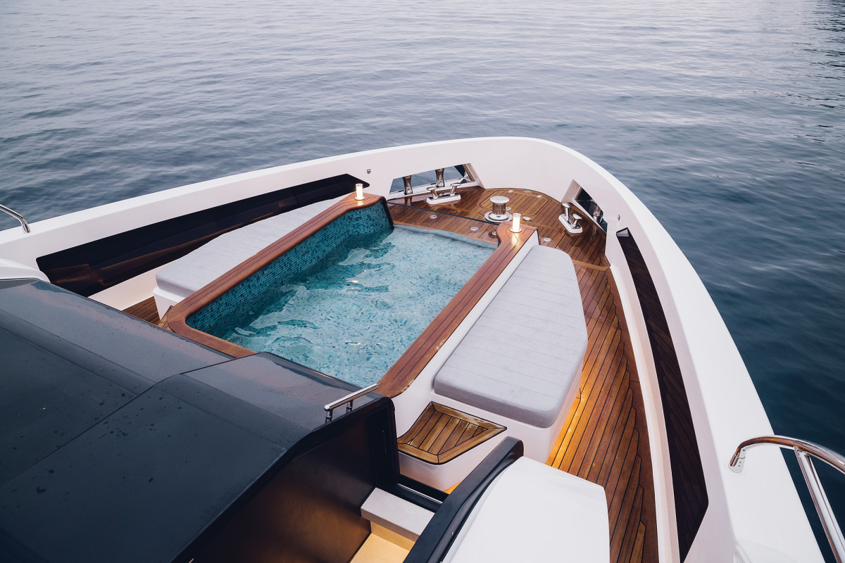 The foredeck's pool claims the spotlight, including teak sidedecks, a glass front and sunpads on either side.