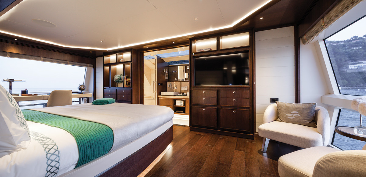 The full-beam master stateroom is an elegant affair, with floor-to-ceiling windows and a foldout balcony.