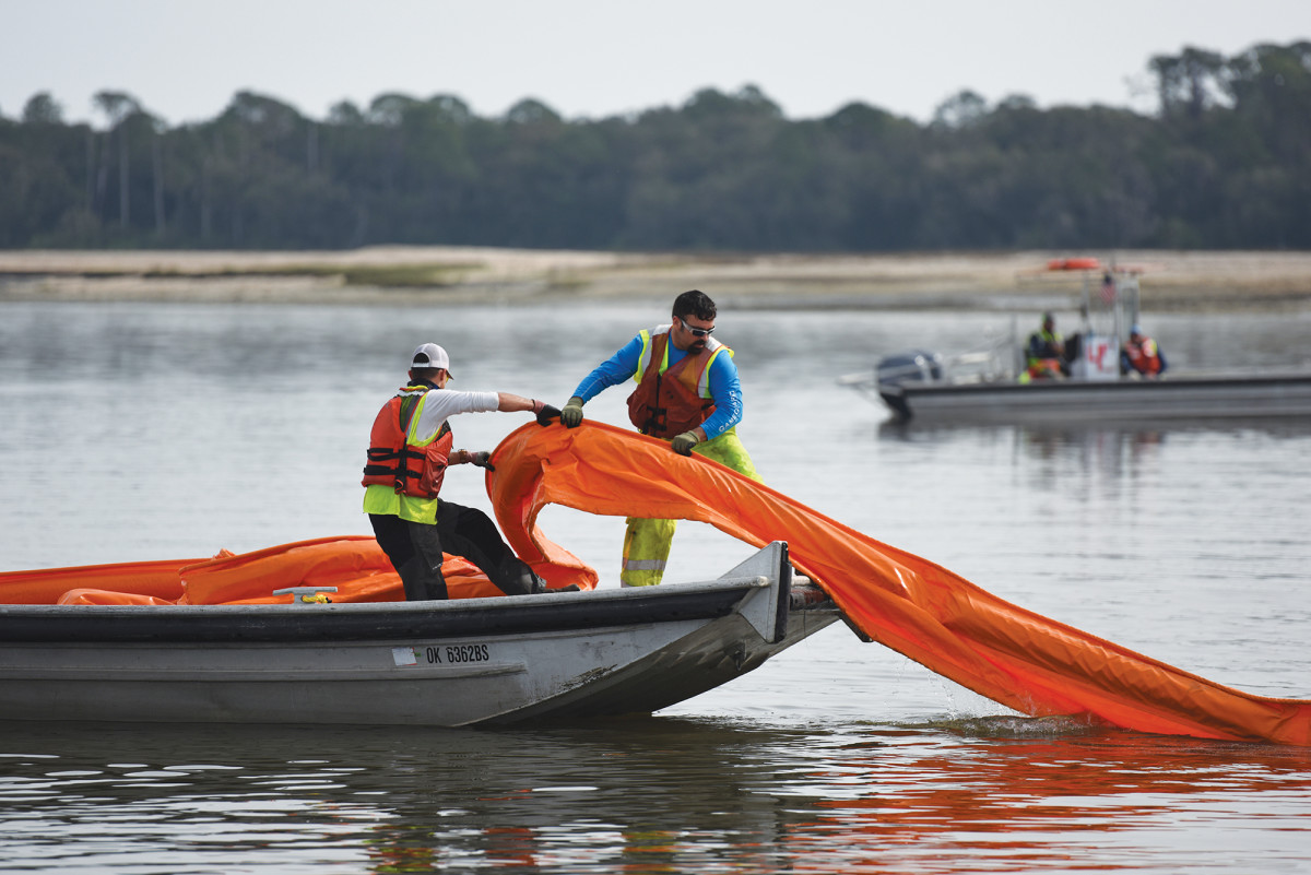 The morning after the Golden Ray inexplicably capsized, booms were deployed to protect St. Simons Sound and its verdant environs from a potential oil spill.
