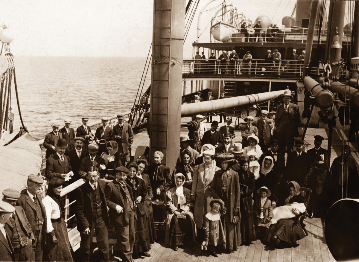 Passengers on deck await departure.
