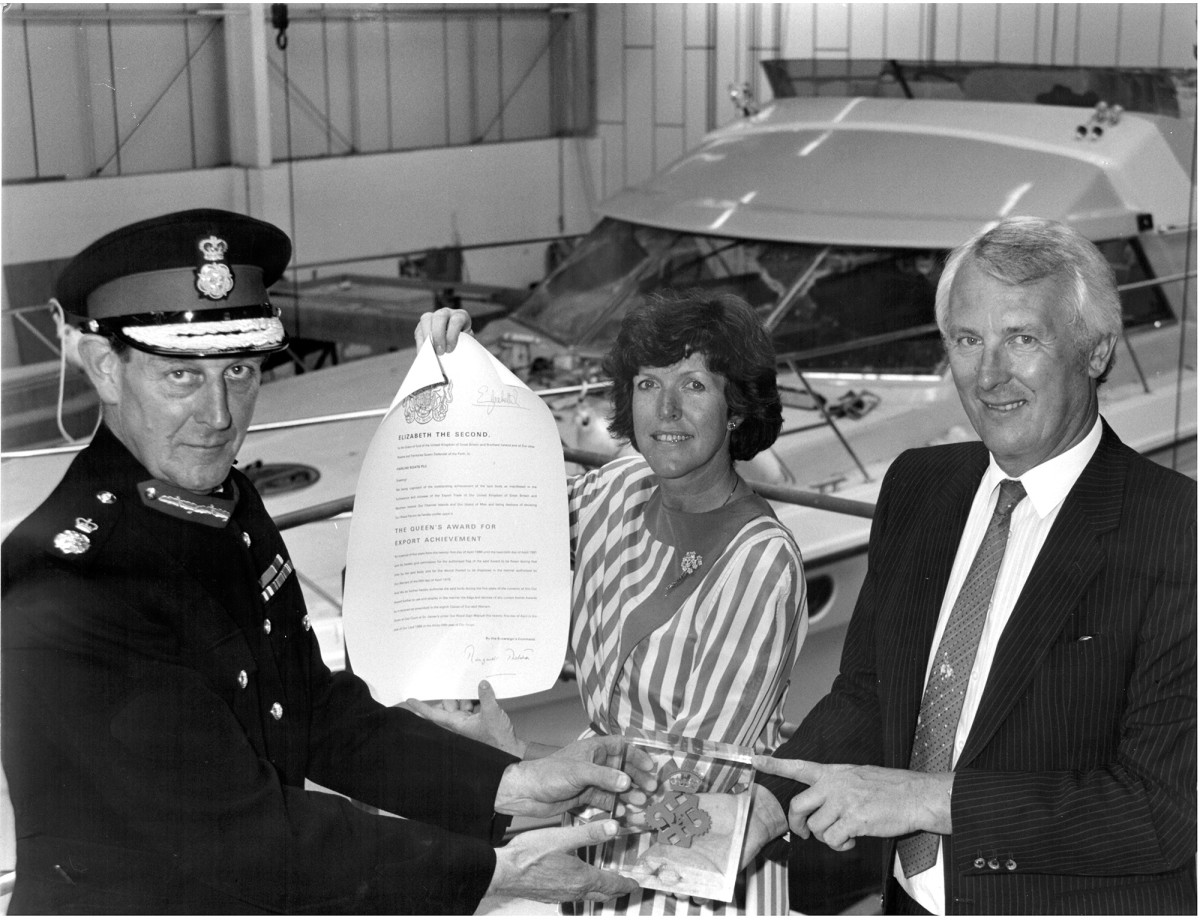 Sam and Briony Newington stand in front of the Fairline 50 as they receive their first Queen's Award for Export Achievement in 1986.