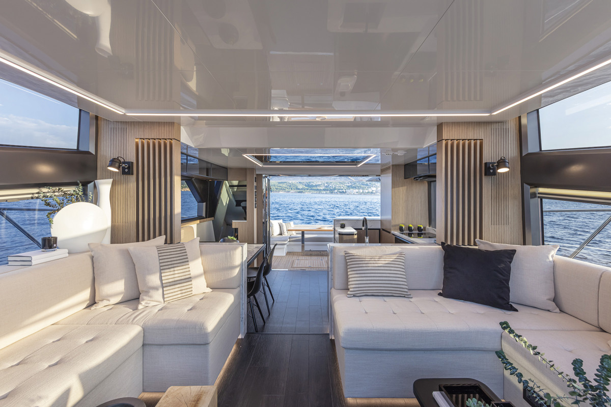 The layout of the main deck is particularly successful, with its discrete salon seating area forward, which flows nicely into an aft galley.