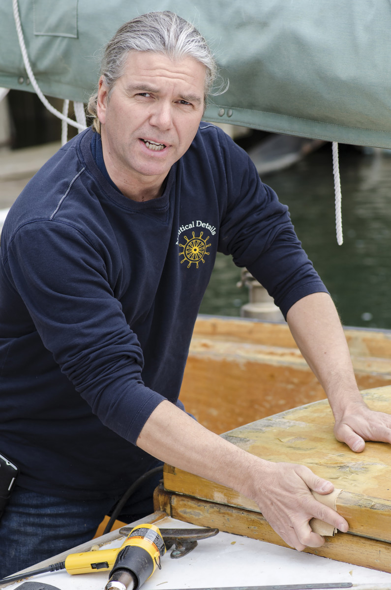 Tobi Keitmeier of Nautical Details removes the finish from an old sailboat hatch.