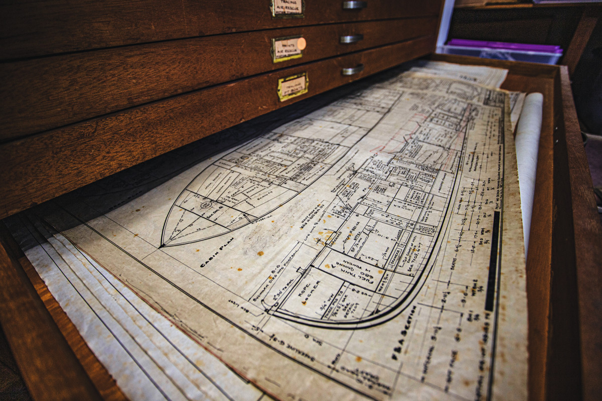 Hand-drawn plans for a World War II PT boat rest inside a wood drawer at Huckins.