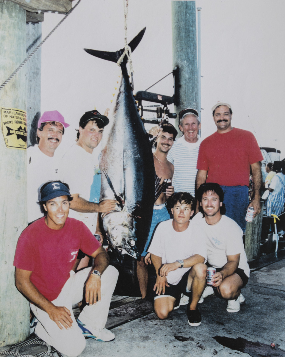Chris (kneeling, left) was well-known and loved in the fishing community.