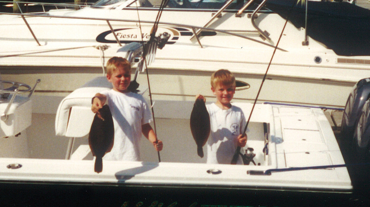Sean and Justin proudly display their catch.