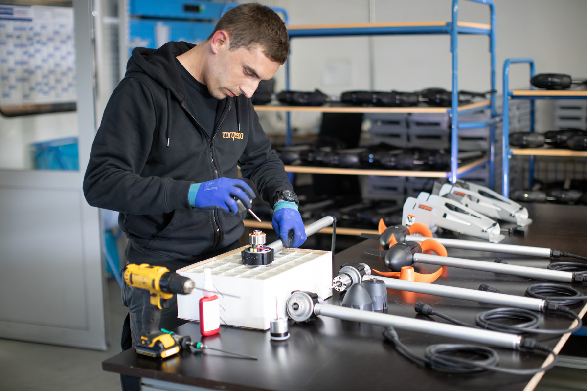 A technician building an electric outboard.