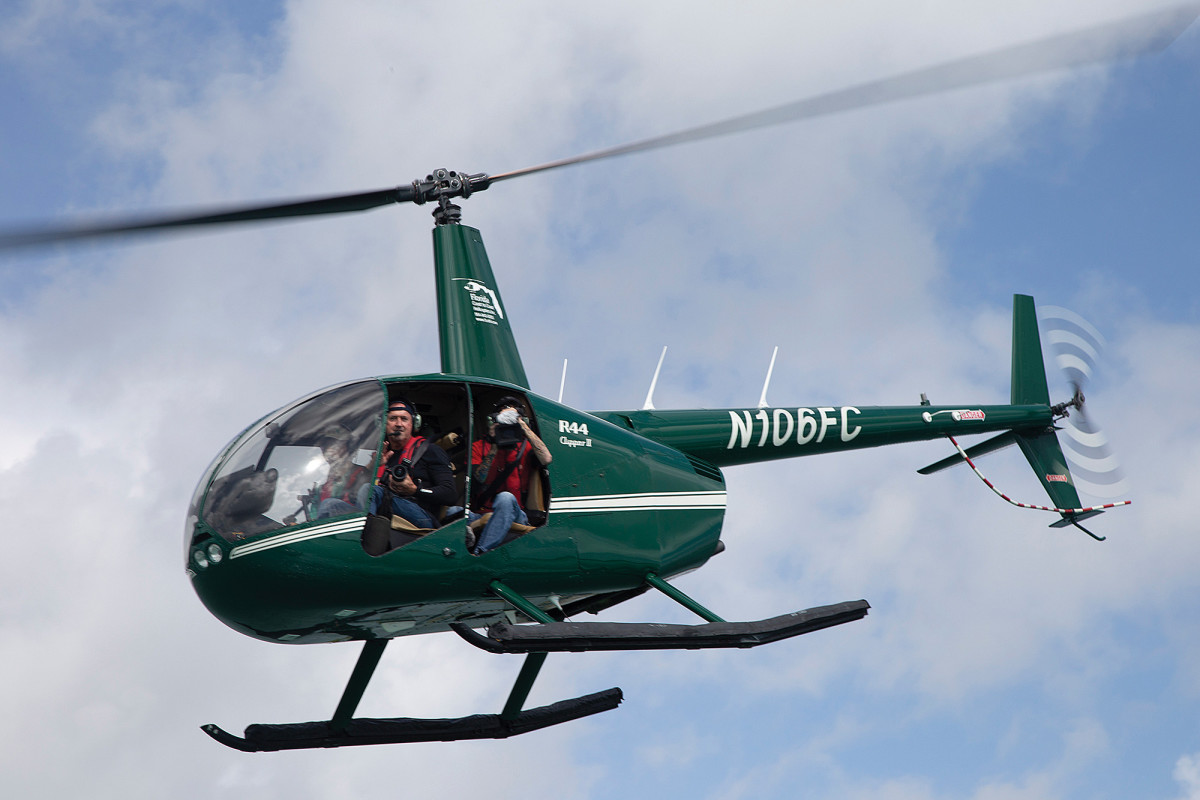 A helicopter circles loudly overhead, the sole paparazzo charged with documenting the poker run from the skies.