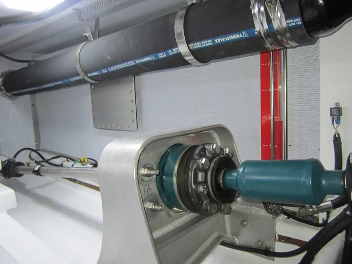 """This AquaDrive transfers the thrust of the shaft directly to the hull before it reaches the transmission and engine. Solidly attached to the hull, the frame takes the load, allowing the engine to """"float"""" on soft mounts."""