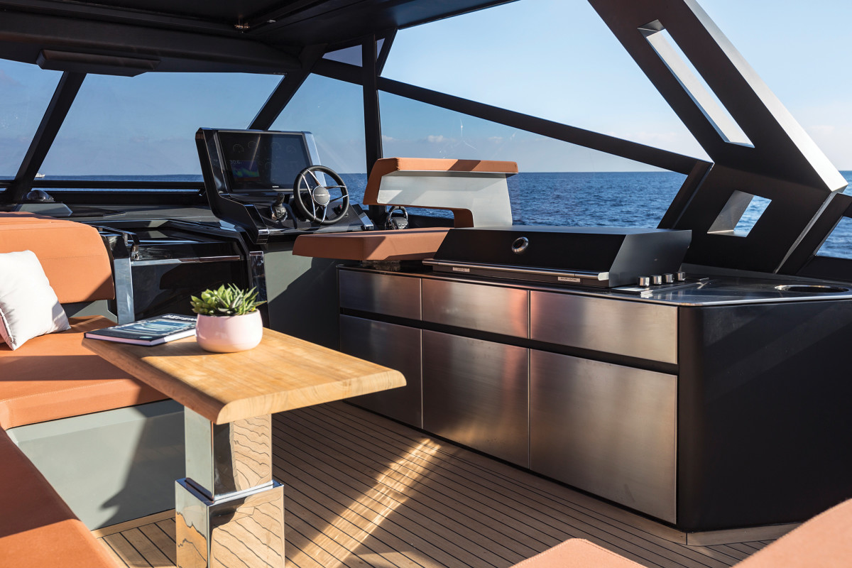 Salt and sun—you're looking at the benefits of an open plan. The helm station is accompanied by a chaise lounge to port and a party-sized grill.