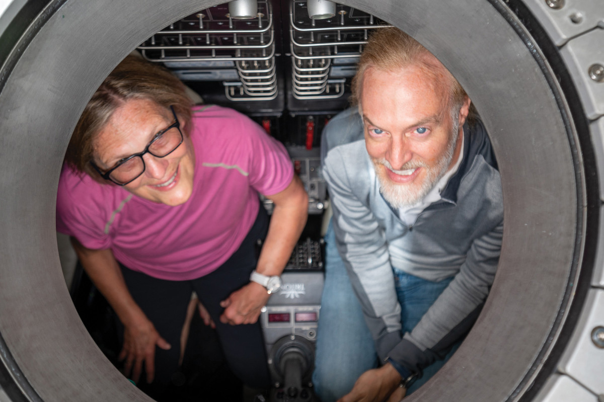 """Dr. Sullivan and Victor Vescovo inside """"Limiting Factor"""". While the outside environment is extremely hostile for humans, Sullivan says sitting in the submersible is just as comfortable as flying in the economy section of a commercial airliner."""