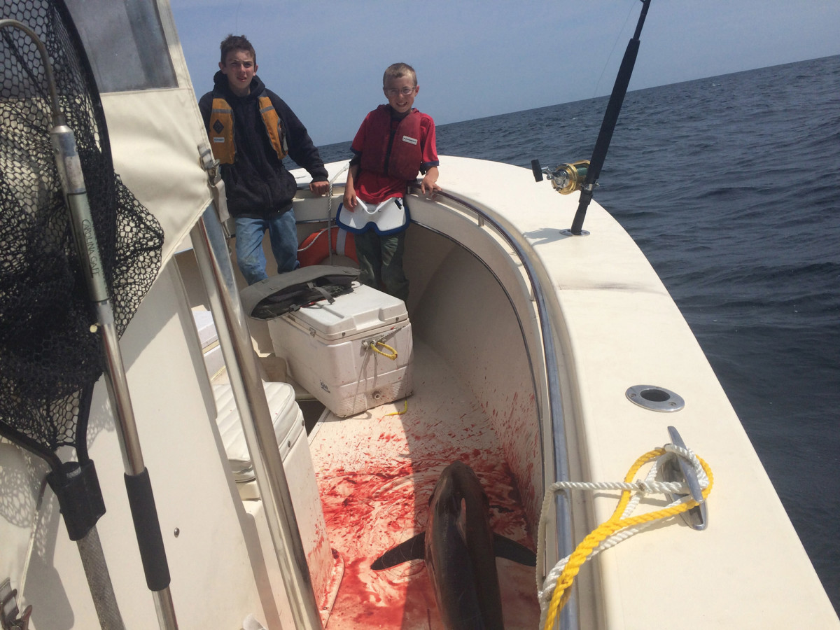 This is the stuff that memories are made out of (also, judging by all that blood, maybe a few nightmares too). The boys stand proudly next to a boated shark somewhere off of Rhode Island. It's the culmination of a good bit of hard work, and a whole lot of nagging dad to take them out.